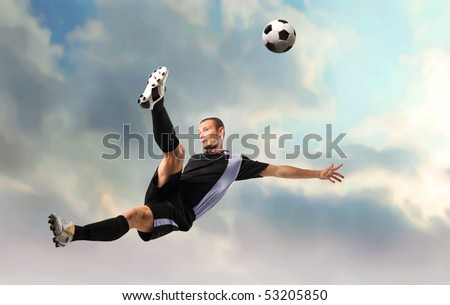 Young man playing soccer - stock photo