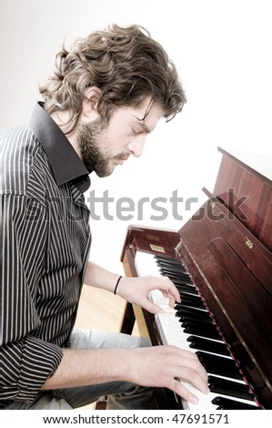Young man playing the piano - stock photo
