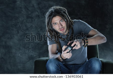 Young man playing Videogames - stock photo
