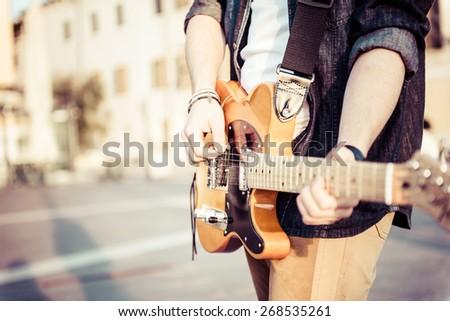 young man plays guitar - stock photo