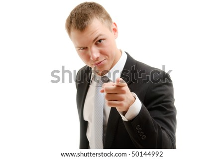 Young man pointing at camera. Isolated on white. - stock photo