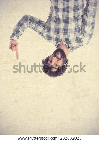 young man pointing at down - stock photo