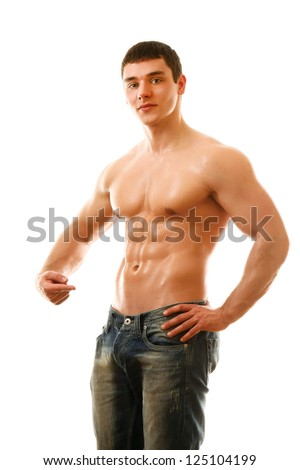 Young man pointing at his abs isolated on white background