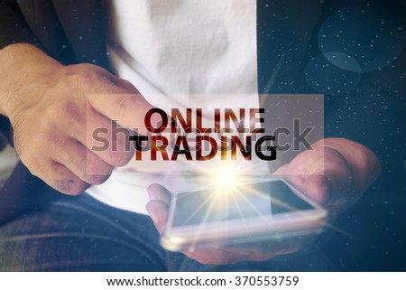 young man pointing at ONLINE TRADING  text on virtual screen. soft light with vintage filter. Internet concept. Business concept. Business idea - stock photo