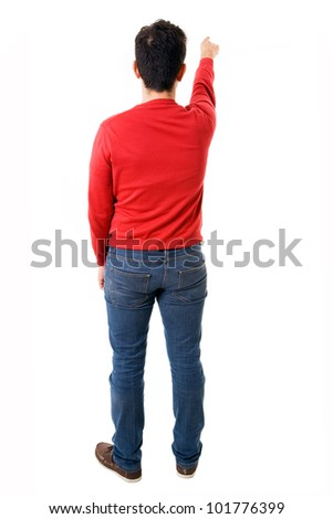 Young man pointing from back, isolated on white - stock photo