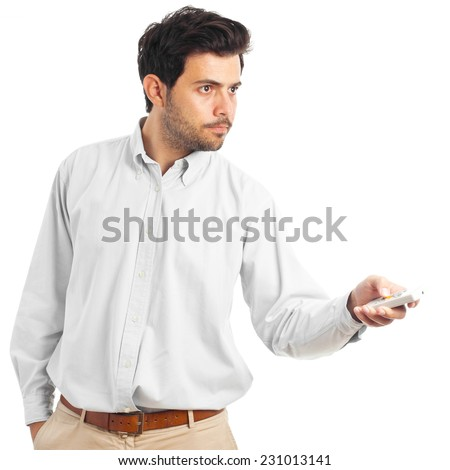 young man pointing with a remote control on a white background - stock photo