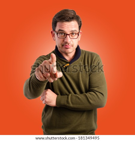 Young man pointing with his finger - stock photo