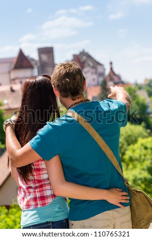 Young man pointing woman the castle architecture travel vacation love - stock photo