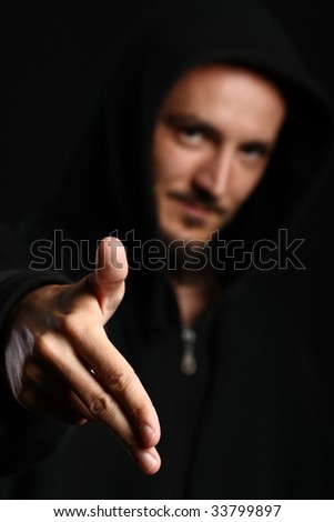 Young man points his two fingers down in a classic hip-hop manner simulating a gun - stock photo