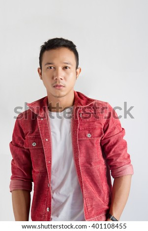 young man portrait in white shirt and red jacket  on gray background,man in white shirt,man in red jacket,asian man,asian man portrait - stock photo