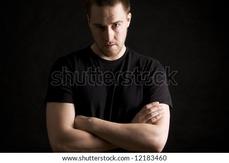 young man portrait on black background - stock photo