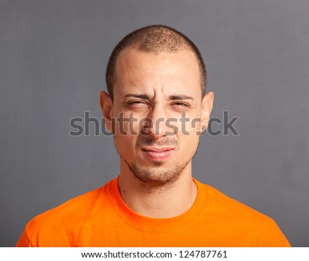 Young Man Portrait on Grey Background - stock photo