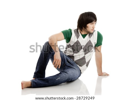 Young man portrait seated over a white background - stock photo