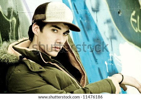 Young man portrait under urban background - stock photo