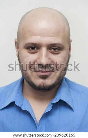 Young man portrait with bald head in blue shirt, id like photo - stock photo
