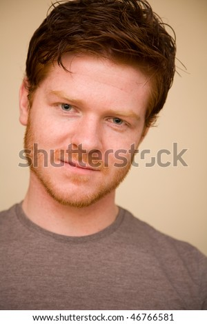 Young man poses, he has ginger hair