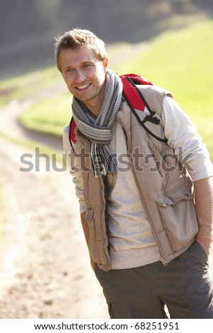 Young man poses in park - stock photo