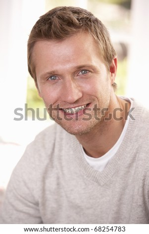 Young man poses in studio - stock photo