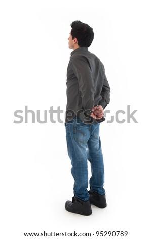 Young man posing backwards against white background. - stock photo