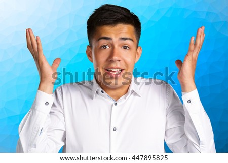 """Young man posing """"don't know"""" - stock photo"""