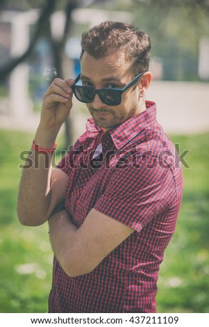Young man posing in front of the camera. - stock photo