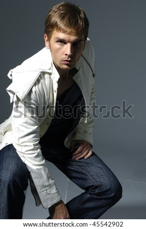 Young man posing isolated over white