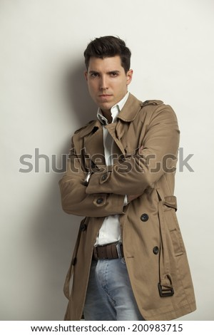young man posing on gray background in a Trench Style Raincoat