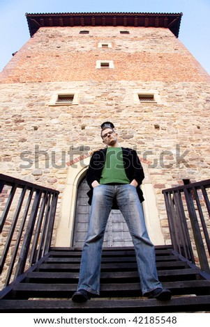 Young man posing on the stairs.