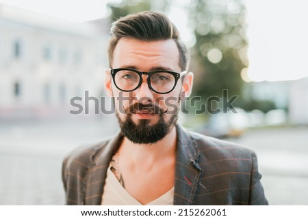 young man posing on the street - stock photo