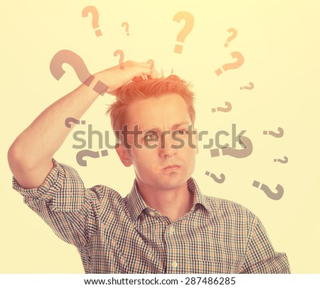Young man posing thoughtful on white background - isolated - stock photo