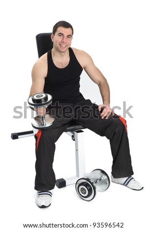 young man posing with dumbbells sitting on bench, on white background