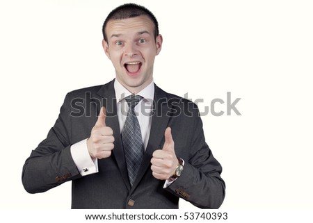 "Young man posing with ""thumbs up"" - stock photo"