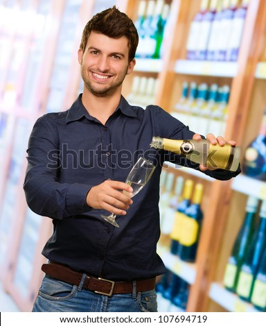 Young Man Pouring Champagne, Outdoor