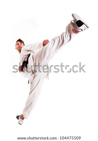 Young man practicing martial arts over white background - stock photo