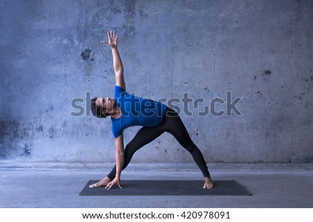 Young man practicing yoga