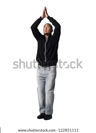 Young man practicing yoga against white background - stock photo