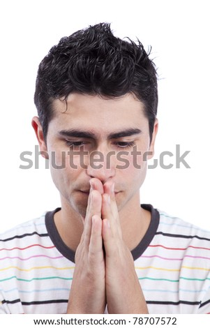 Young man praying (isolated on white) - stock photo