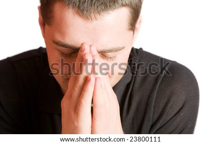 Young man praying with eyes closed closeup isolated on white - stock photo