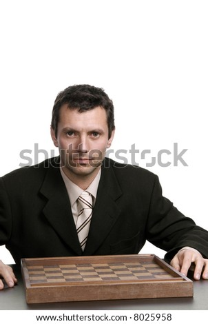 young man prepares to play a game isolated on white