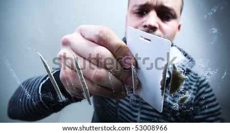 Young man preparing cocaine dose. - stock photo