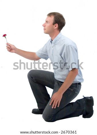 Young man presenting a flower. - stock photo