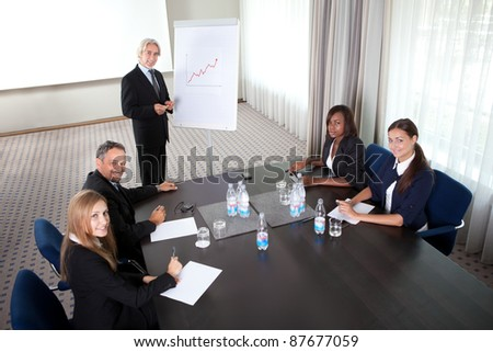 Young man presenting his ideas to colleagues - stock photo