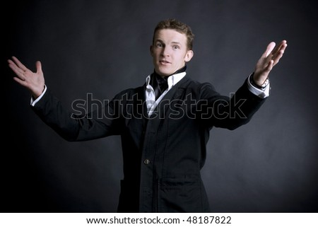 young man presenting show - stock photo