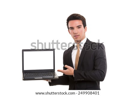 Young man presenting your product in a laptop computer - stock photo