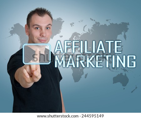 Young man press digital Affiliate Marketing button on interface in front of him - stock photo