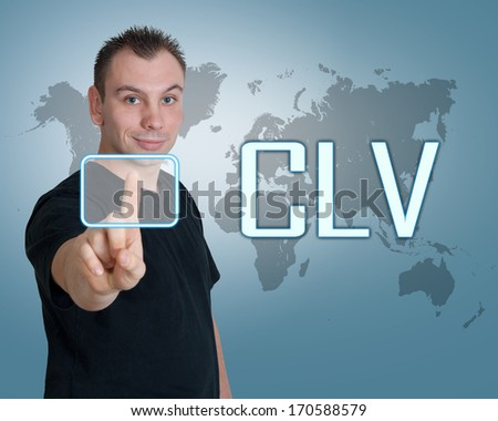Young man press digital Customer Lifetime Value button on interface in front of him