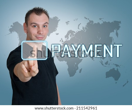 Young man press digital Payment button on interface in front of him - stock photo