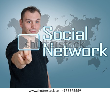 Young man press digital Social Network button on interface in front of him - stock photo