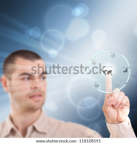Young man pressing modern touch screen buttons - stock photo