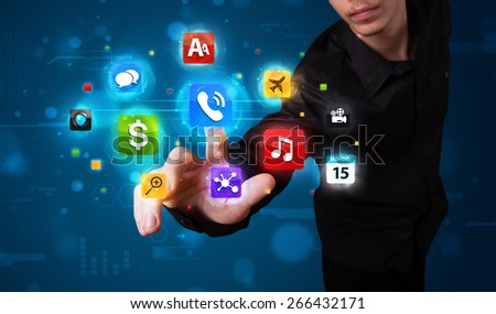 Young man pressing various collection of high tech buttons - stock photo